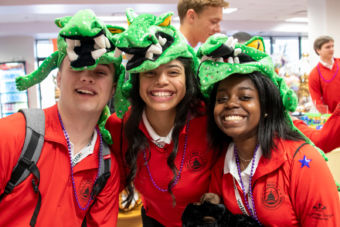 YLC Arizona Representative, Victoria Lucero, smiles at the camera with her fellow YLC representatives while wearing crocodile hats at NRECA's Annual Meeting in New Orleans.